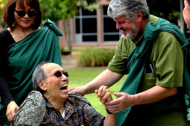 Richard Kekuni Blaisdell, center, with his daughter Nalani Blaisdell, left, and University of Hawaii Dr. Kalani Brady, right, in the John A. Burn School of Medicine's Native Hawaiian Healing Garden.