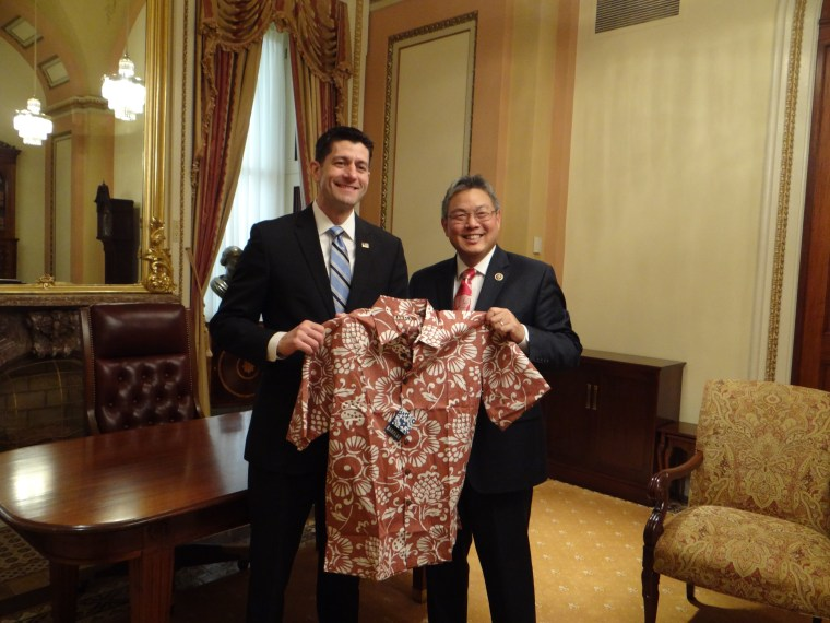 Rep Mark Takai (D-HI) giving House Speaker Paul Ryan an aloha shirt to encourage Ryan to allow Aloha wear to be worn on the House floor on Fridays.