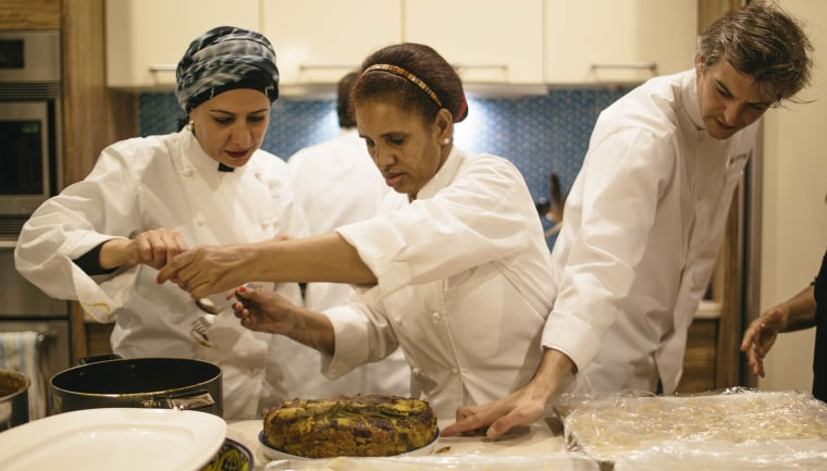 Eat Offbeat chefs work together to cook authentic home-style ethnic meals.