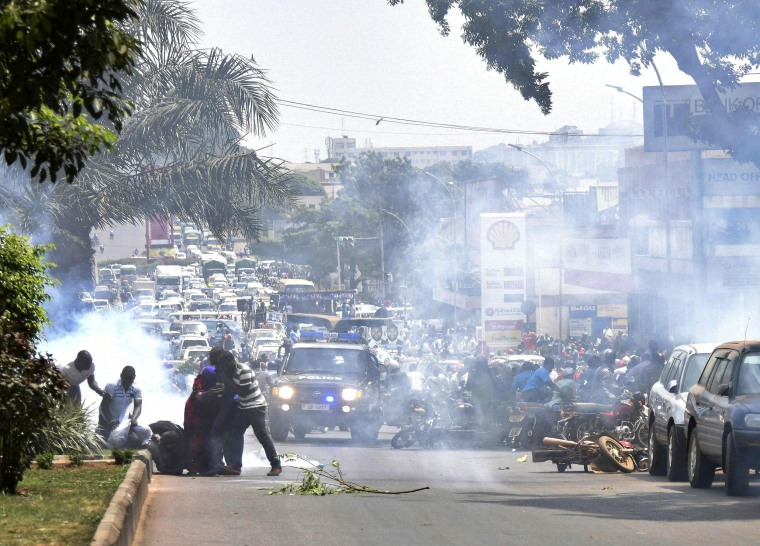 Image:Ugandan police fires tear gas in Kampala