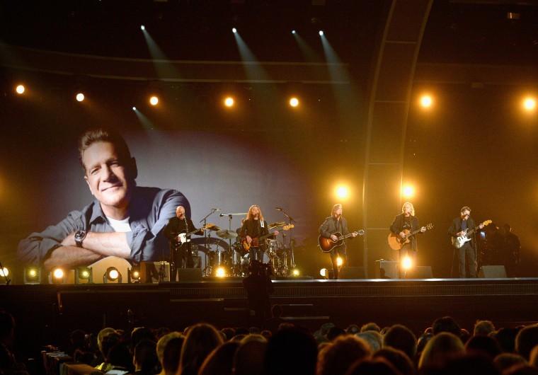 Image: Musicians Bernie Leadon, Timothy B. Schmit, Jackson Browne, Joe Walsh and Steuart Smith, honoring Eagles founder Glenn Frey, perform onstage