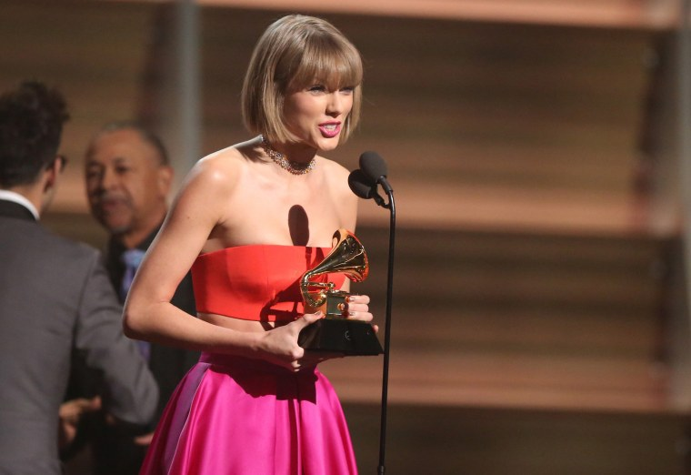 """Image: Taylor Swift accepts the award for album of the year for """"1989"""""""