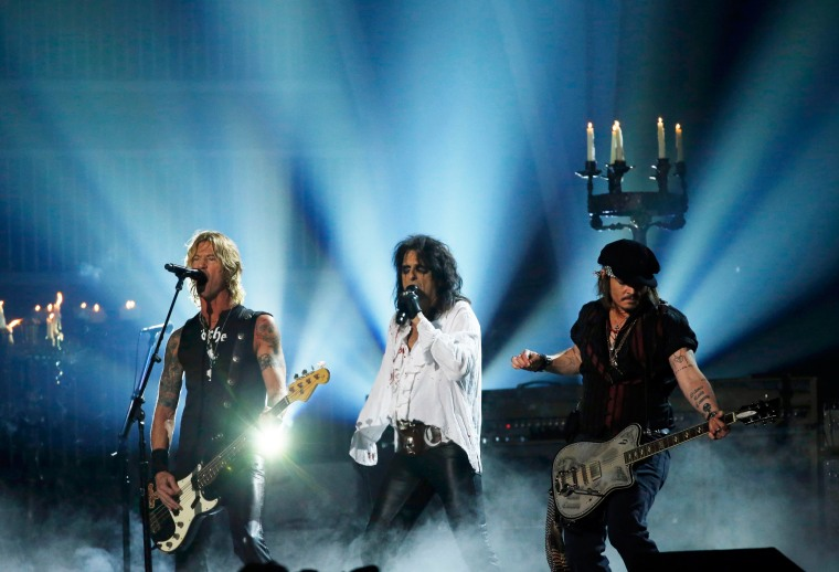 """Image:  Duff McKagan, Alice Cooper and Johnny Depp of the band Hollywood Vampires perform \""""As Bad As I Am\"""""""