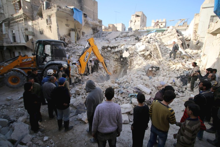 Image: Civil defence members search for survivors after airstrikes by pro-Syrian government forces in the rebel held al-Qaterji neighbourhood of Aleppo