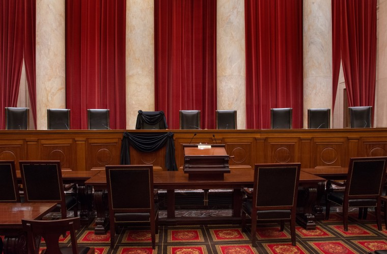 Image: The Courtroom of the Supreme Court showing Associate Justice Antonin Scalia's Bench Chair and the Bench in front of his seat draped in black following his death on Feb. 13, 2016.