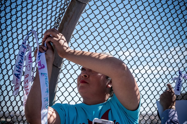 As they made their way across the border, the women stopped to tie ribbons with names of immigrants on barbed wire fences.