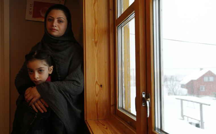 Image: Afghan asylum seekers Sufya Nawabi, her daughter Helanar, pose for a photograph in her temporary apartment