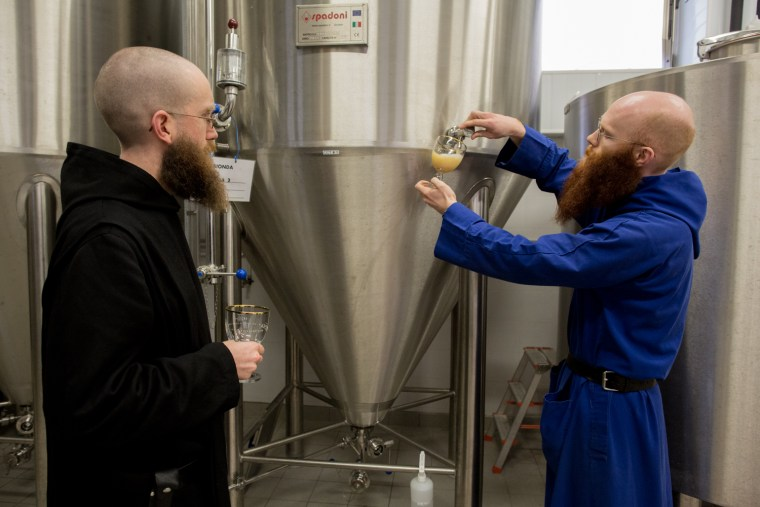 Father Benedict, left, and Brother Augustin, right, help to brew Birra Nursia.