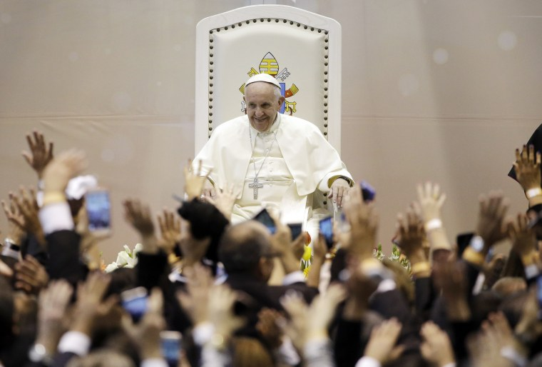 Image: Pope Francis smiles as members of the World of Work organization wave at him in Ciudad Juarez