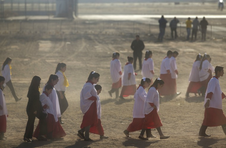 Image: Choir girls walk to the entrance of the Benito Juarez International Airport