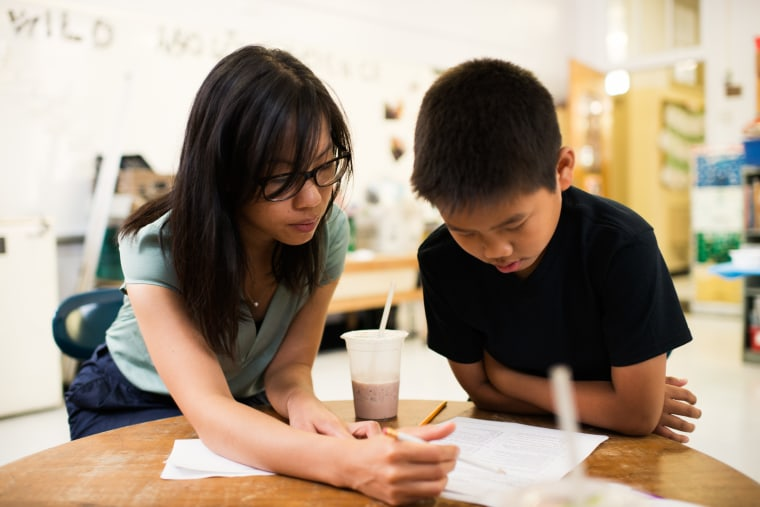 An Apex for Youth tutor works with a student. One hundred percent of the proceeds from the 2016 Lunar New Year Festival will benefit the organization.