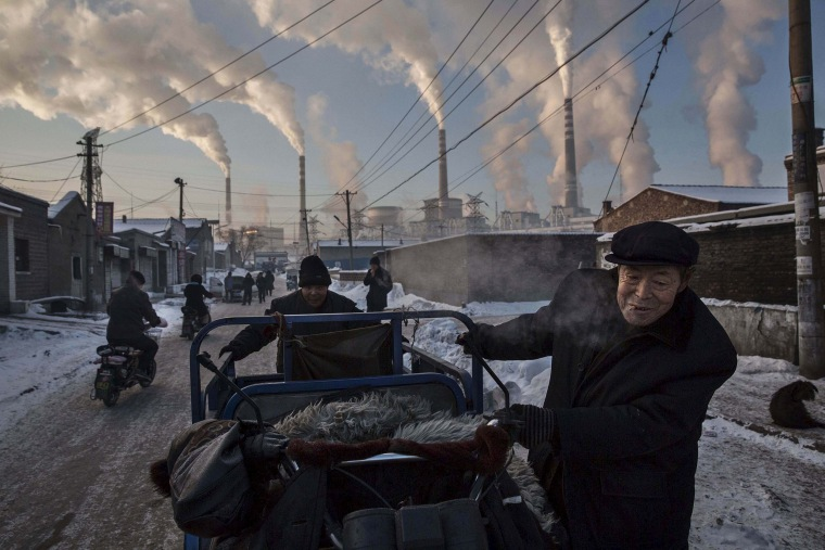 Image: Daily Life, 1st prize singles - Kevin Frayer - China's Coal Addiction
