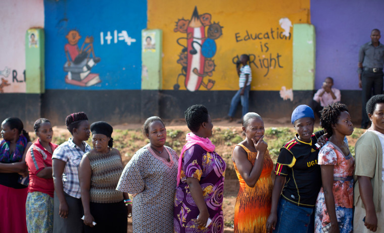 Image: Ugandans queue to cast their votes outside a polling station located at a school in Kampala, Uganda