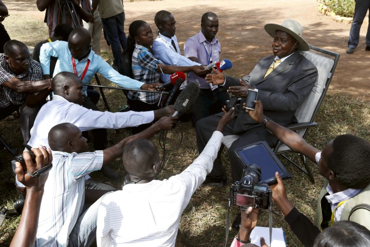 Image: Uganda's incumbent President Yoweri Museveni speaks to the media soon after casting his vote at a polling station during the presidential elections in Kirihura in western Uganda