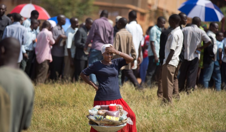 Image: A woman sells nuts to hungry Ugandan voters queuing at a polling station