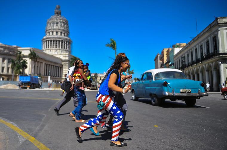 Image: A woman walks along a street of Havana