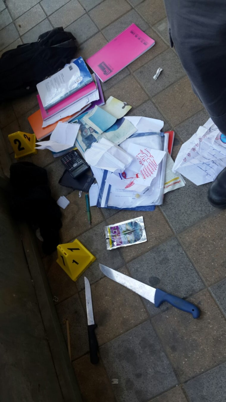 Image: Contents of the teenage attackers' schoolbags on the ground