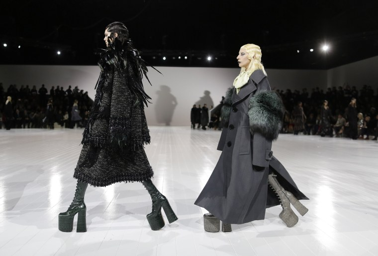 Image: Lady Gaga, right, circles the runway after modeling an outfit near the end of the Marc Jacobs Fall 2016 collection