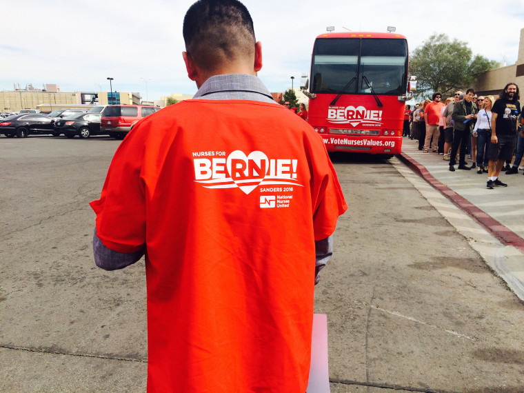 A Bernie Sanders supporter with a nurse's union stands near a bus parked outside a high school where Bernie Sanders held a rally in Las Vegas this week.