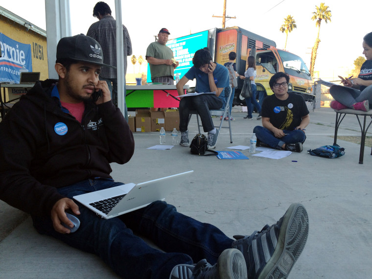 Austreberto Hernandez, of Las Vegas, makes get out to caucus calls for Bernie Sanders.