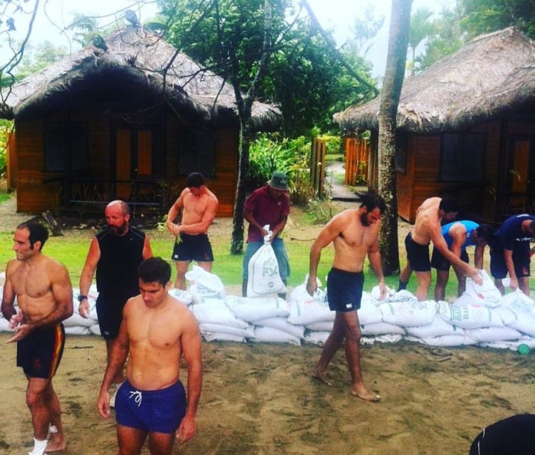 Spain's Ruby Sevens team assisting a local resort in Fiji with storm preparations.