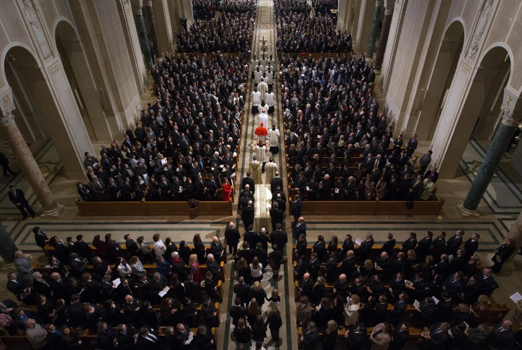 Image: Scalia's casket is carried into the church during the procession.