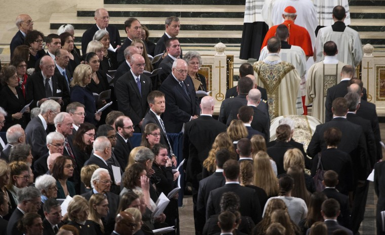 Image: Guests look to the procession during Scalia's funeral