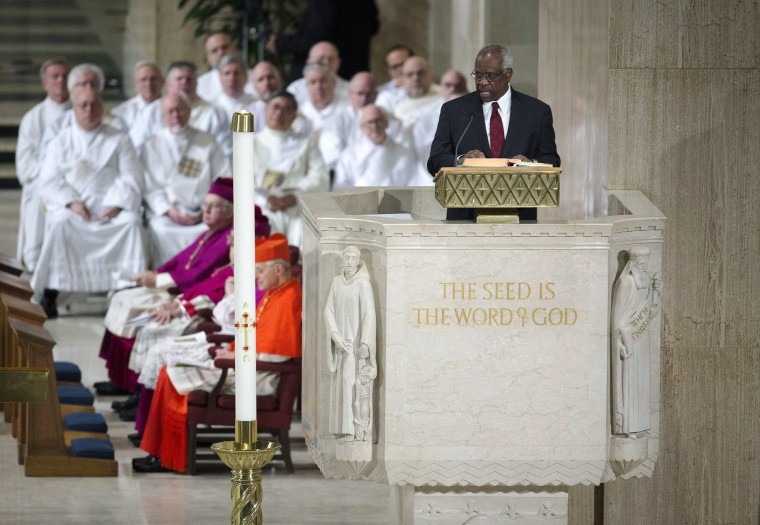 Image: Justice Clarence Thomas reads during the funeral Mass for Justice Antonin Scalia