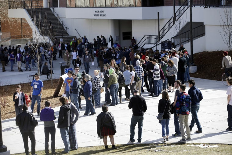 Image: People line up to participate in the Democratic caucus in Reno