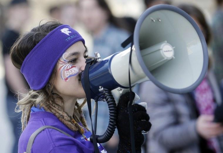 Image: Precinct captain Hayley Hageman instructs people through a bullhorn