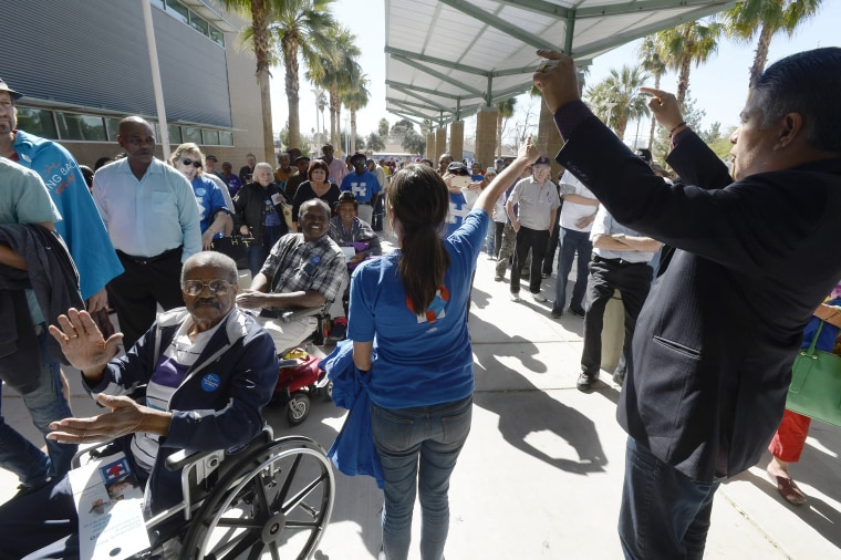 Image: Congressman Tony Cardenas, right, from California encourages Hillary Clinton caucus goers