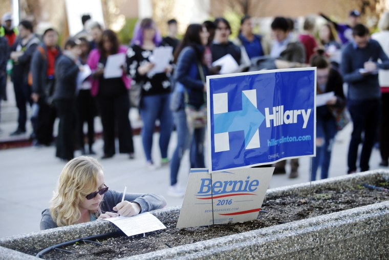 Image: Kara Bonham, at left, registers to vote for the Democratic caucus