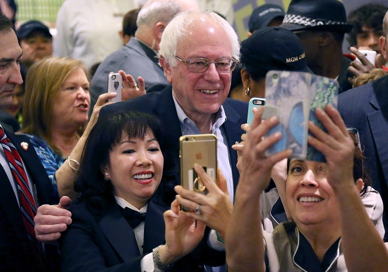 Image: Sanders greets workers in the cafeteria of the MGM Grand Casino