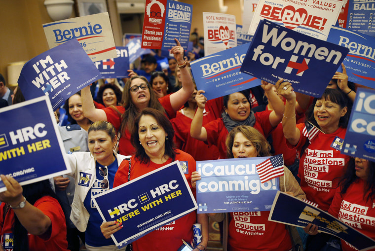 Image: Supporters of Hillary Clinton and Bernie Sanders cheer on their presidential candidates