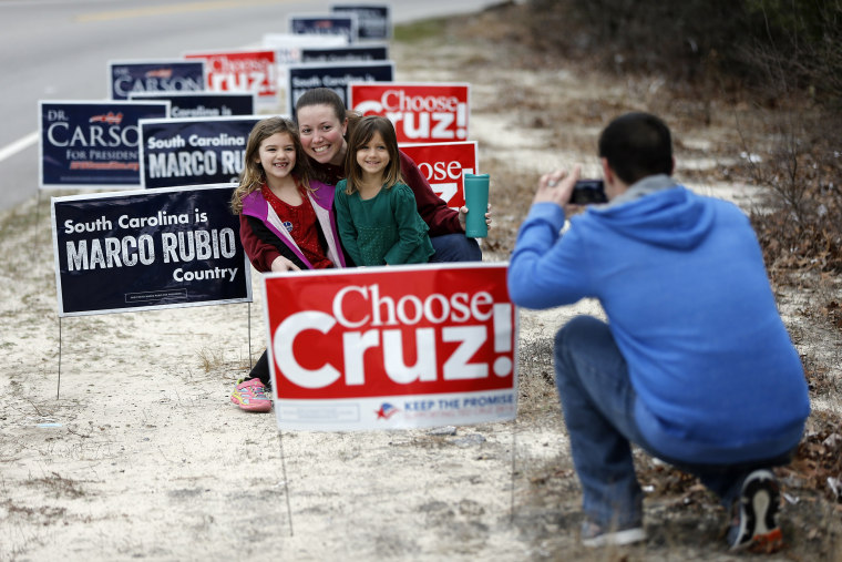 Image: A family take pictures after voting in the South Carolina Republican presidential primary