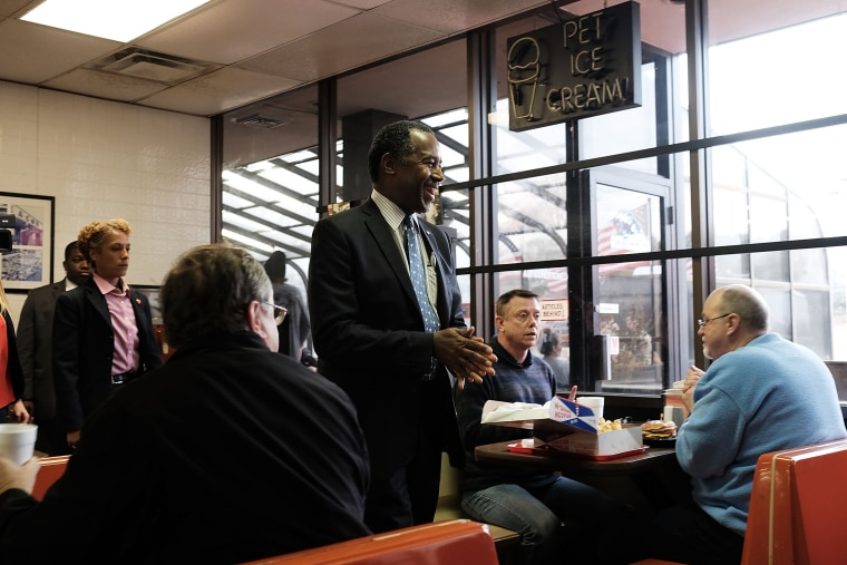 Image: Republican presidential candidate Ben Carson visits voters