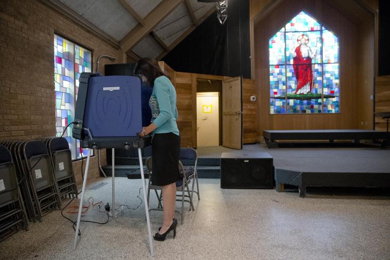 Image: South Carolina Gov. Nikki Haley votes in the Republican presidential primary