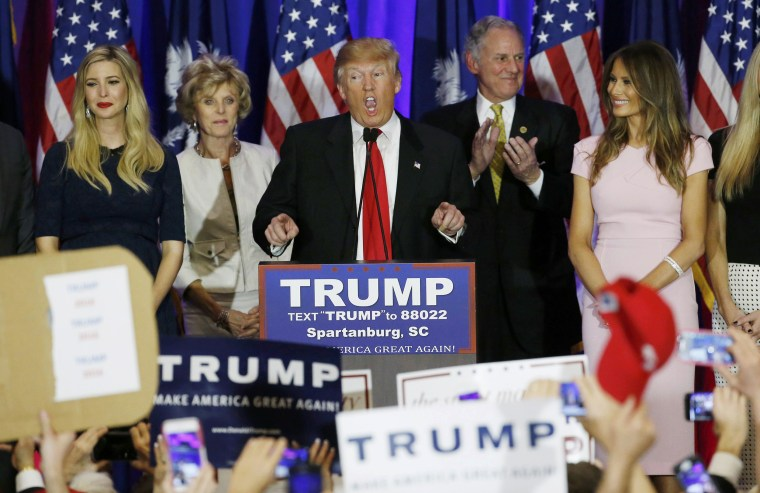 Image: Republican U.S. presidential candidate Donald Trump speaks with his daughter Ivanka and his wife Melania at his sides at his 2016 South Carolina presidential primary night victory rally in Spartanburg