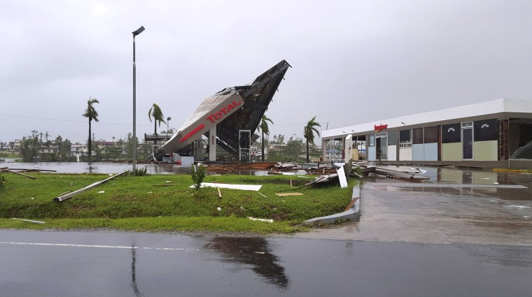 Image: A service station lays in ruin after Cyclone Winston swept through the town of Ba on Fiji's Viti Levu Island