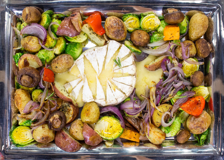 Sports Illustrated model Robyn Lawley cooks up a Brie cheese fondue with roasted vegetables