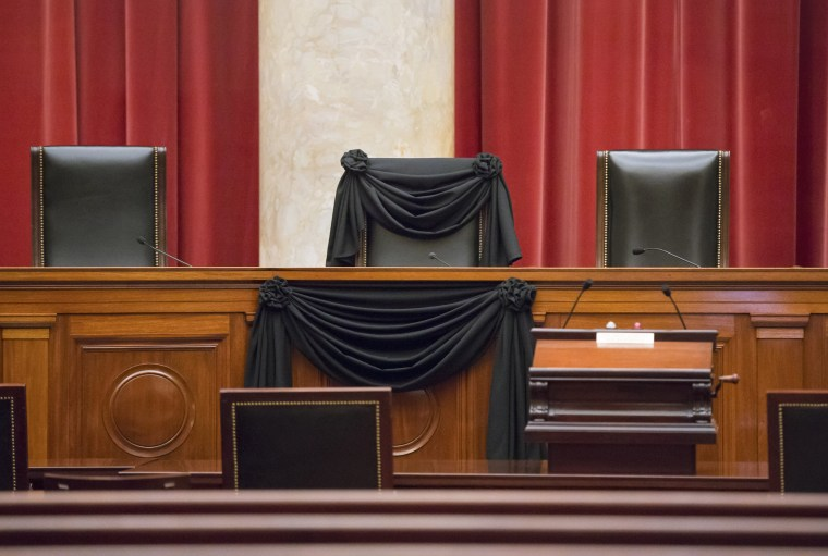 Image: Supreme Court Justice Antonin Scalia's courtroom chair is draped in black to mark his death