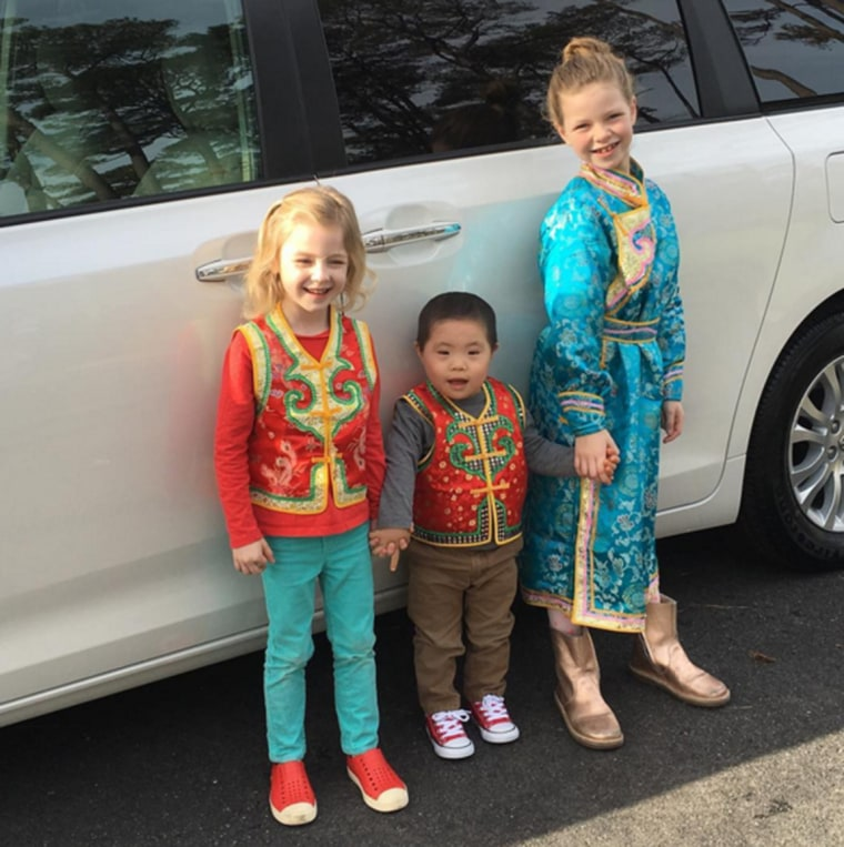 Image: Ben and his two sisters, Addie and Carter, celebrate Chinese New Year
