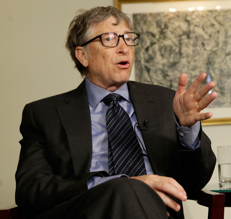 Image: Bill Gates talks to reporters