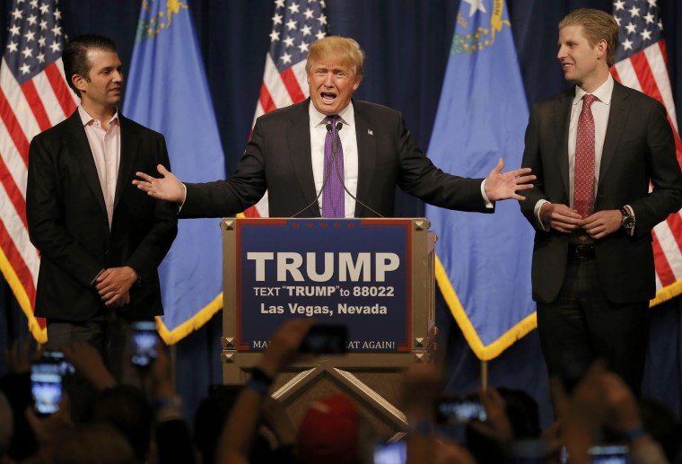 Image: Republican U.S. presidential candidate Donald Trump is flanked by his sons Donald Jr. and Eric as he addresses supporters after being declared by the television networks as the winner of the Nevada Repulican caucuses at
