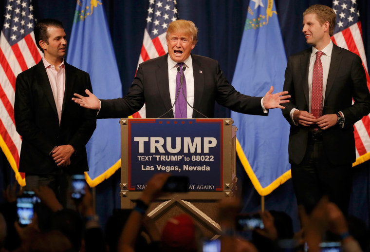 Image: Republican U.S. presidential candidate Donald Trump is flanked by his sons Donald Trump Jr. (L) and Eric Trump