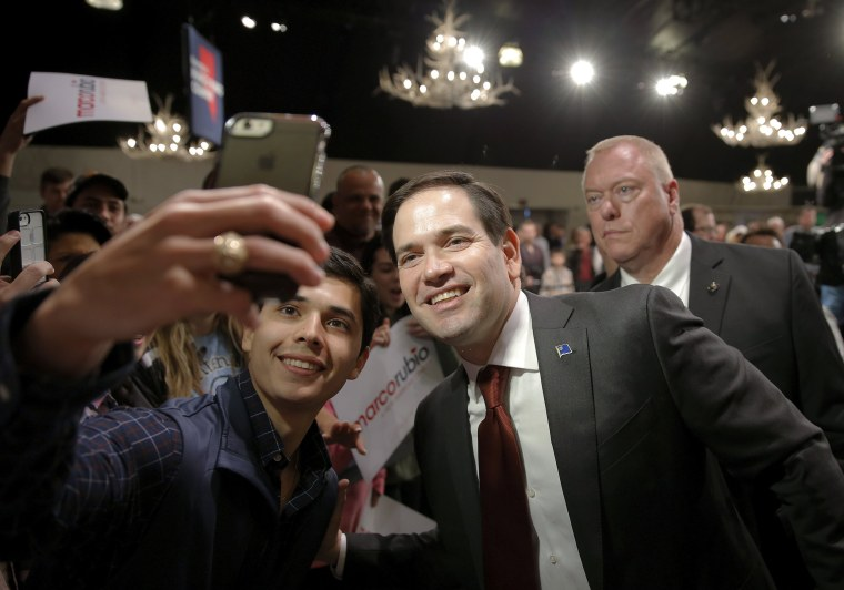 Image: Marco Rubio poses for a photo with a supporter