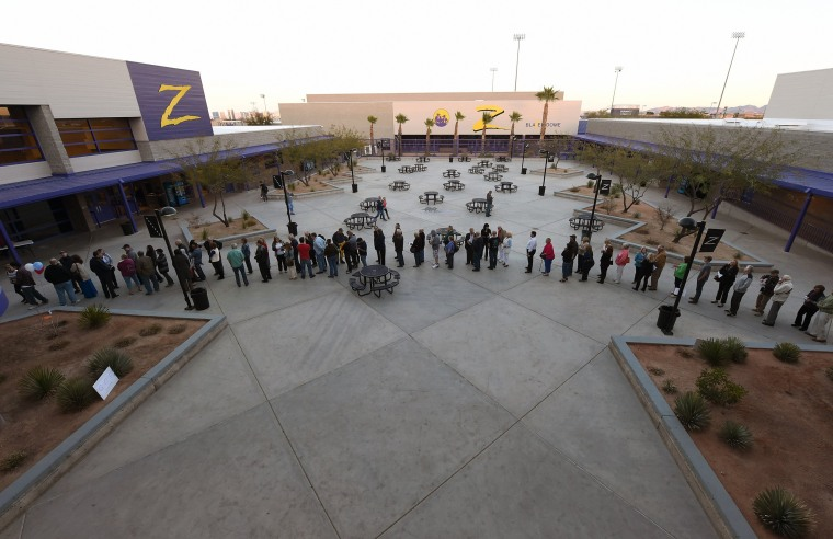 Image: Voters line up to vote at a local high school