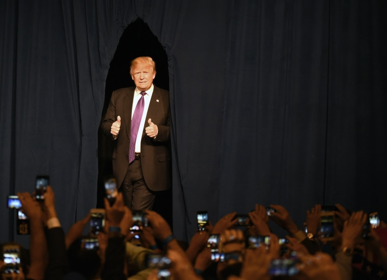 Image: Donald Trump arrives at a caucus night watch party