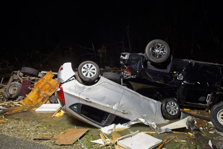 Image: Destroyed trailers and vehicles at park lay strewn across the park