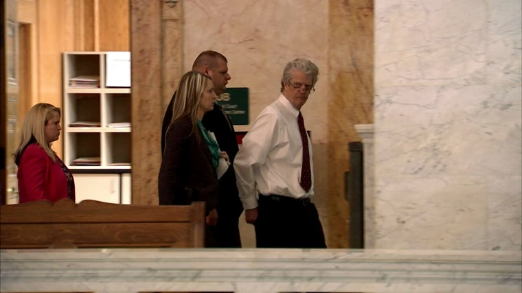 Bob Leonard is led away from the courtroom after his conviction on Feb. 24 in Fort Wayne, Indiana.
